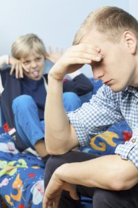 How to discipline an ADHD child | photo of defiant child and tired dad