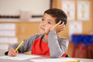Auditory Processing   Photo of boy daydreaming in class