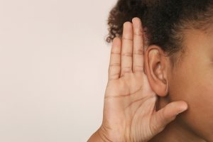 Auditory Processing   Photo of child holding hand up to ear