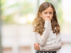 Anxiety In Children | photo of young girl biting nails