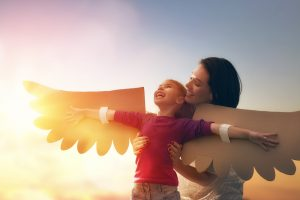Emotional Regulation Skills | photo of mom holding daughter wearing paper wings