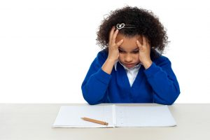 Executive Functioning Skills | photo of distressed child staring at blank paper