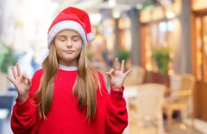 Holidays with ADHD Children | photo of zen tween in xmas hat