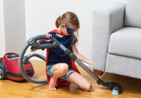 Sensory Diet | photo of kid doing heavy work vacuuming