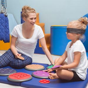 Sensory Issues | photo ofChild with a band on eyes during sensory integration therapy