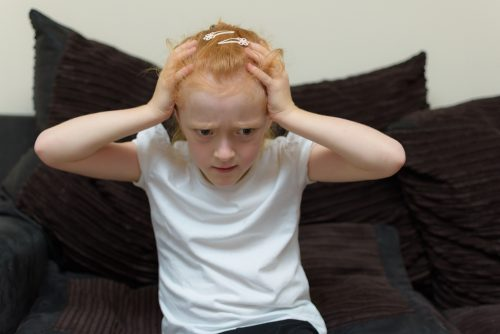 Sensory Overload | photo of distraught girl clutching head