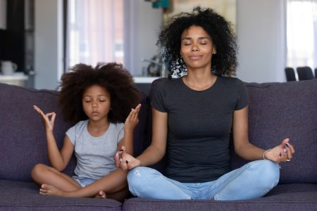 How To Calm Anxiety | photo of mom and daughter meditating together