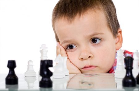 How To Calm Anxiety: photo of boy staring at chess pieces