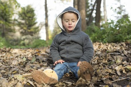 Calming Anxiety | photo of child sitting in autumn woods