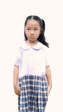 Anxiety in Kids | photo of unhappy schoolgirl in uniform looking sideways