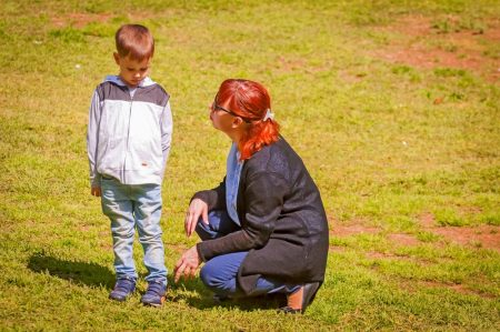 Social Skills Training | photo of mom counseling sad boy on field