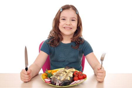 ADHD Diet | girl eating healthy lunch of fish rich in fatty acids