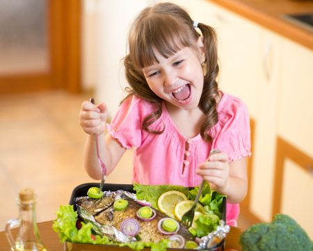 ADHD Diet | photo of girl getting her fatty acids through deluxe fish meal