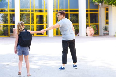 social anxiety in children | photo of parent leading reluctant child into school